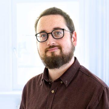 Portrætfoto af Lasse Højmark Petersen